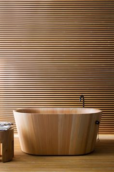 This contemporary Japanese wooden bathtub illustrates the continual use of natural materials, simply designed.