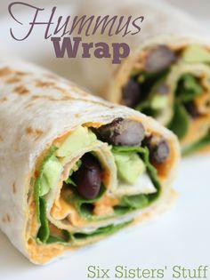 Looking for a healthy lunch? These Hummus wraps taste so good and are full of protein! Sixsistersstuff.com