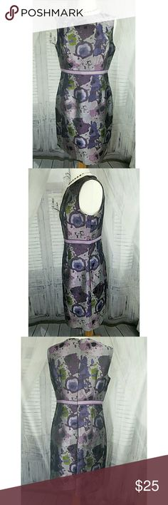 Nine West purple accents dress size 12 Perfect for your special occasions! This is a beautiful and classy dress without being boring . Watercolor like designs with a grosgrain ribbon accent sewn into the waist. Invisible zipper in the back. For a point of interest the right front shoulder area has small crystal beads sewn onto some of the coordinating ribbon. The design of this dress is wonderful! Like new condition. Nine West Dresses Midi