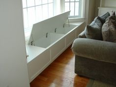 Window seat with storage - good idea for the bay in the dining room. I can store all the table cloths, napkins, place mats, etc, there! Add cushions for seating in the meantime. More room design storage 3 Creative Storage Solutions for the Family Room Traditional Family Rooms, House, Window Seat Storage, Home, Built Ins, Creative Storage Solutions, New Homes, Home Diy, Seat Storage