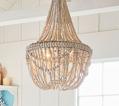 Shop francesca beaded chandelier from Pottery Barn. Our furniture, home decor and accessories collections feature francesca beaded chandelier in quality materials and classic styles. Chandeliers, Wood Bead Chandelier, Round Chandelier, Pendant Lighting, Boho Lighting, Chandelier Makeover, Vintage Chandelier, Beach House Decor, Beach Houses