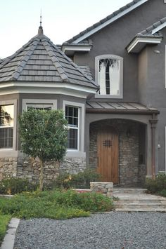 Home sweet home! Theres my stucco!!-Grey stucco house with stone-loving the color! and michael loves the stones!