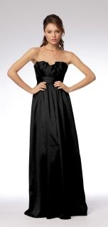 Black, but with a wide purple ribbon across waist, tied into medium/small bow in back