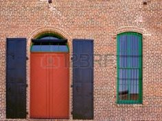 yellow window seal on red brick house - Google Search