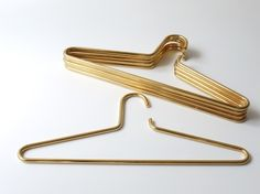 Brass Clothing Hangers by Carl Aubock