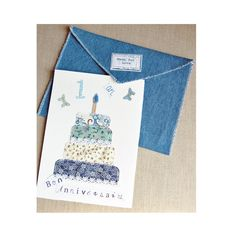 Bithday card, with a blue cake, Happy birthday card , a nice card mixing paper and textile, cake in printed fabric, cut and sewn on the card,