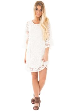 Lime Lush Boutique - White Lace Round Neck Shift Dress with 3/4 Sleeves, $39.99 (https://www.limelush.com/white-lace-round-neck-shift-dress-with-3-4-sleeves/)