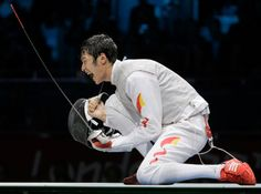 Lei Sheng of China reacts to winning the gold medal after defeating Alaaeldin Abouelkassem of Egypt, at men's individual foil fencing final.