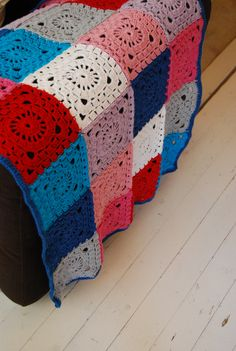 pink, blue, red, white, grey and lilac blanket
