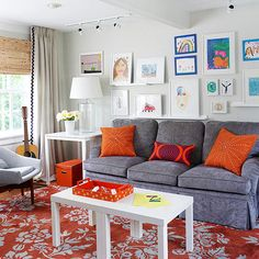 This cheerful living room is anything but formal. Designed to accommodate the needs (and artistic efforts) of a busy family, it combines comfortable seating, easy-clean coffee tables that double as workstations, and an overscale patterned area rug that hides spills! http://www.bhg.com/rooms/living-room/makeovers/living-room-decorating-ideas/?socsrc=bhgpin041415artisticlivingroom&page=9