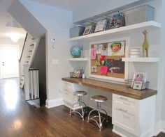 Having a space in the great room where everyone can work and play was an important factor in the design plans. In the transitional area, where the addition meets the original home, a craft area was built for daughters Brooke and Grace; vintage pieces dot the shelves.