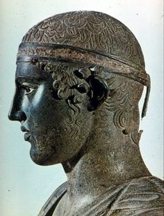 "Side view of the head of the ""Charioteer of Delphi""."
