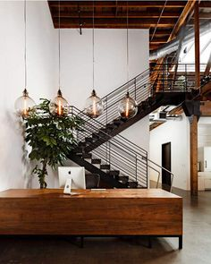 Mid-century inspired desk with incredible staircase. What a grand place to work!