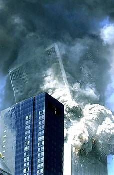 South Tower tilts & falls on 9-11-01. The South tower was the second tower hit but the first to fall.