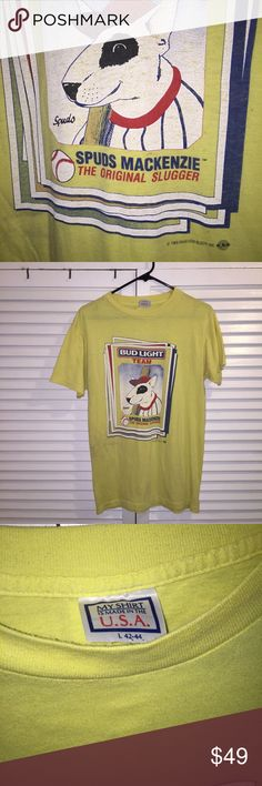 Vintage Bud Light Team Tee ft. Spuds Mackenzie ⚾️ Unisex Vintage Very Rare 88' Anheuser-Busch Yellow Bud Light Beer Team T-Shirt with original doge hero & Party Animal 🐶 Spuds Mackenzie⚾️ 🍻 Slight dark discoloration on middle right of the shirt seen in picture 2. Size: Adult Large. Vintage Shirts Tees - Short Sleeve