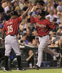 Houston Astros.  Coach Dave Clark (35) greeting Jimmy Paredes (38) after he hit a home run off Colorado Rockies starting pitcher Alex White!