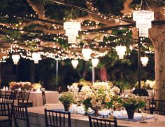 I like the atmosphere from the lights and greenery above the tables.  Real California Wedding - Kristina & Paul - The Bride's Cafe
