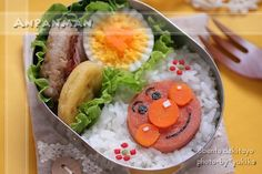 An adorable Anpanman bento! I wonder if I could make this with lunch meat, nori, and carrot rounds...
