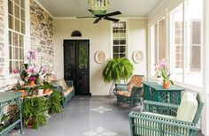A Stunning Estate with Southern Grace and Italian Romance:  antique wicker furniture painted charleston green