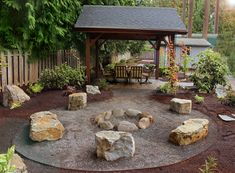 Natural stone seating and rock fire pit Backyard Bbq Pit, Fire Pit Backyard, Cozy Backyard, Landscaping With Rocks, Backyard Landscaping, Landscaping Ideas, Fire Pit With Rocks, Small Fire Pit, Fire Pit Seating