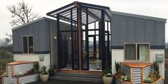 Two Tiny Houses and a Sunroom Combine to Comfortably Fit a Family of Four