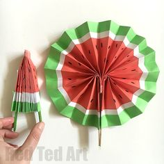 DIY Paper Fans - love this Melon Fan version, so cute!! Great paper toy for kids. Great for popping in our pocket too. Make them plain paper, scrapbook paper or create your own funky designs. Wonderful Wedding Favours or crafts for kids for summer. How to make paper fans!