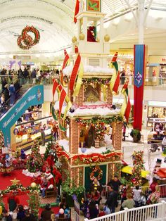 Santa Claus and holiday decorations galore at SouthPark Shopping Mall in Strongsville Ohio.  Great photo of Santa with children too from ParadeOfGardens.com's photos of area Holiday Scenes, Christmas Trees and Winter Gardens.    http://www.paradeofgardens.com/
