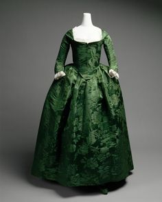 """Gown: ca. 1775, American, silk damask, shown with neck lace and engageantes. A transition between Robe à l'anglaise (notice the """"petticoat"""" and skirt are one piece, not two) and the """"Round Gown."""""""
