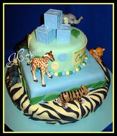 http://cakedecoratingcoursesonline.com/cake-decorating/ Jungle Themed Baby Shower Cake. #Create Your Own #Baby #Shower #Cake - Learn How to #Decorate Cakes - Visit Online Cake Decorating Classes on http://CakeDecoratingCoursesOnline.com
