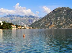 Photo about Photo of Kotor bay with cristal water and a blue sky - Kotor Bay - Montenegro - July 2010. Image of mountains, july, photo - 113951982