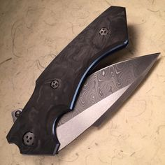 White Swan with 2 tone Damascus blade and marble carbon fiber scales…