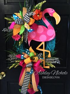 What a cute fun flamingo wreath!!! Flamingo is made of 1/2 plywood. Painted with outdoor quality paint. Painted black on the back for that