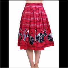 Jump N Jive Pinup Rockabilly Skirt Brand new! Fantastic 50s style cotton print with Rock 'n' Roll dancers and records.   Secured at the rear with a concealed zip and hook and eye fastening. 2 side pockets. Can be worn with or without a petticoat.   The skirt is red, black and white.  Fit Advice: This style runs true to size. There is some stretch to the fabric.  Washing Advice: Machine washable   Fabric: 97% Cotton, 3% Elastane Skirts A-Line or Full