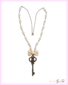 Unlock the secrets of a beautiful heart with this gorgeous necklace. White and ivory pearl beads decorate the delicate antique gold-tone chain, showing off the lovely ribbon bow and key. Choose one of 2 styles for the key pendant: Heart or Filigree. Who knows what secrets youll discover?  ❥Antique gold tone key charm, approximately 3 long ❥Antique gold-tone metal alloy chain ❥Glass beads ❥Satin ribbon accent ❥Chain length: 28 ❥Lobster clasp closure ❥Perfect jewelry for classic lolita fashion…