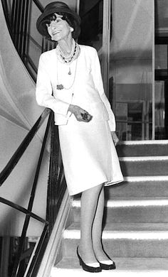 Coco Chanel wearing her own design on the stairs of her atelier in Paris, 1969.