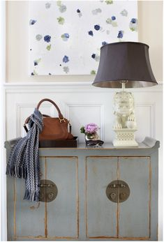 great treatment of an asian style cabinet - gray  & gold