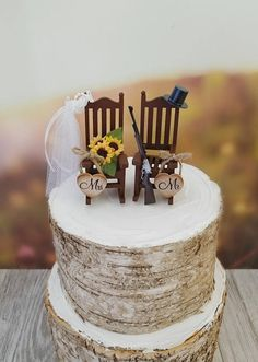 miniature sunflower rocking chair wedding cake topper shotgun rifle hunting theme hat veil camping groom rustic country themed bride groom wedding cake sunflowers Sign in Country Wedding Cakes, Wedding Cake Rustic, Country Weddings, Country Grooms Cake, Hunting Grooms Cake, Western Wedding Cakes, Cake Wedding, Hunting Themes, Wedding Cake Fresh Flowers
