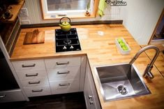 Kootenay Tiny House on Wheels by Green Leaf Tiny Homes 004 GREAT LITTLE HOUSE...LOVING THE LAYOUT OF KITCHEN.
