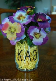 Perfect example of following the theme.  Kappa Alpha Theta colors are gold and black and the flower is a pansy.  #theme #centerpieces