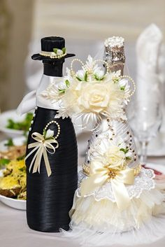 We have collected some awesome wedding bottle decor ideas. It will make your wedding table decorations perfect. Check out these wedding bottle DIY ideas on a budget to get some help. Wine Bottle Covers, Wine Bottle Art, Wine Bottle Crafts, Wedding Bottles, Wedding Glasses, Wedding Crafts, Wedding Decorations, Table Decorations, Bottle Decorations