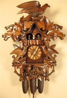 Black Forest Cuckoo Clock, Musical, Hand Carved Hawk, Model #8388. One of our favorites.