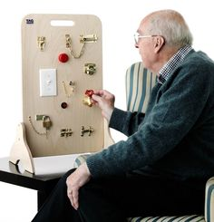 Locks and Latches Board. My kid would love this. And it helps with fine motor skills.
