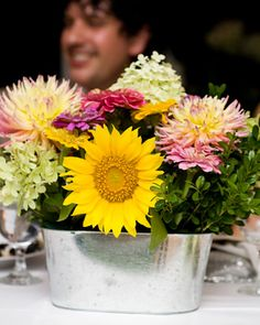 love this with sunflowers and jennie dahlia    Locally Grown Centerpiece                                                        A mix of farm-grown flowers create an arrangement full of color and texture.