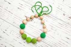 Items similar to Nursing necklace Teething necklace Baby nursing toy Necklace for mom Juniper Wood Organic cotton Green Crochet on Etsy Nursing Necklace, Teething Necklace, Beaded Necklace, Beaded Bracelets, Toy, Trending Outfits, Unique Jewelry, Classic, Handmade Gifts
