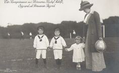 Royals on the field.  Prince Gustaf Adolf, Prince Sigvard and Princess Ingrid of Sweden with their mother, Crown Princess Margaret.  Love little Ingrid's pose here.