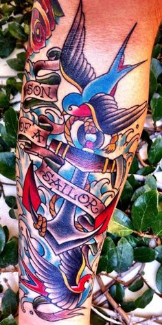 Erika Jurkovic tattooed this traditional piece on a sailor's son. #inked #Inkedmag #traditional #sailor #flash #swallow #art #color