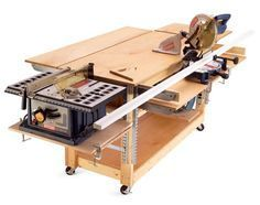 Work bench that uses common shelf brackets for mounting table saw and miter saw on sides of bench. Tools could be stored underneath or in a cabinet when not in use. Can also see potential to mount thickness planer to end where table saw is located and use bench top as an outfeed table.