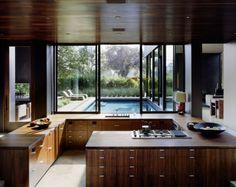 Modern wooden kitchen - Vienna Way Residence by Marmol Radziner