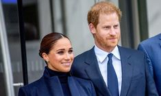 The Duchess of Sussex wore a high-neck sweater with trousers underneath a long coat. Prince Harry and Meghan donned black ensembles for their visit