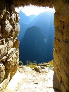 Looking throught the window of the Guard's Hut at sunrise, Macchu Picchu, Peru [3000x4000][OC] - Imgur